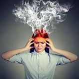 Woman thinks very intensely having headache stock images