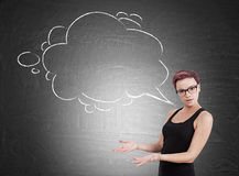 Woman with thought bubble and blackboard stock photography