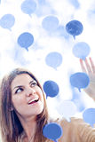 Woman with thought bubbles Stock Photos