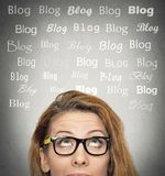 Woman with thoughtful expression, blog words above head Stock Photography