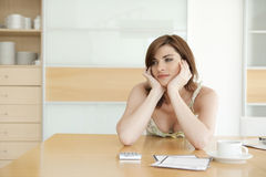 Woman Thoughtful in Kitchen Royalty Free Stock Photos