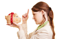 Woman threatening piggy bank Stock Photo