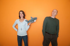 Woman Threatens Man with Toy Royalty Free Stock Photos