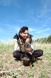 Woman and three dogs. Royalty Free Stock Photography