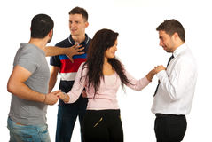 Woman between three guys Stock Image