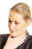 Woman with throat pain Stock Photos