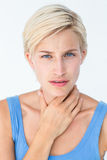 Woman with throat pain looking at camera Stock Images