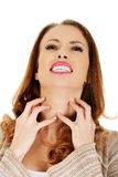 Woman with throat pain. Stock Photography