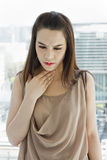 Woman with throat problem, front view Royalty Free Stock Photo