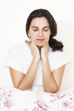 Woman with throat problems Stock Images