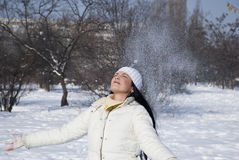 Woman throw snow up Royalty Free Stock Image