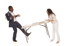 Woman throw table at man Stock Photography
