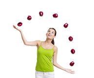 Woman throwing apples Royalty Free Stock Photography