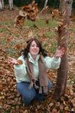 Woman throwing Autumn leaves stock photos