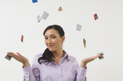 Woman Throwing Away Credit Cards. Portrait of a happy beautiful woman throwing credit cards isolated over white background Stock Photography