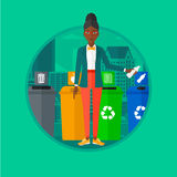 Woman throwing away plastic bottle. Royalty Free Stock Photography
