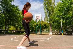 Free Woman Throwing Basketball From Top Of Court Key Stock Photography - 54692352