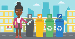 Woman throwing bottle. An african-american woman standing near four bins and throwing a plastic bottle in an appropriate bin on a city background vector flat royalty free illustration