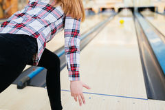 Woman throwing bowling ball. In club Royalty Free Stock Photos