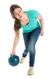 Woman throwing a bowling ball. Isolated over white Royalty Free Stock Photography