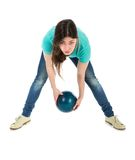 Woman is throwing a bowling ball at a simplistic way. Isolated over white Royalty Free Stock Photo