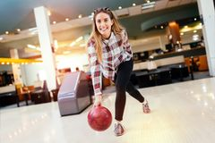 Woman throwing bowling ball. In club Stock Photography