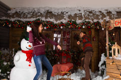 Woman Throwing Cotton Snow to a Guy While Playing Stock Photography