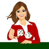 Woman throwing the dice gambling playing craps. Portrait of attractive young brunette woman throwing the dice gambling playing craps on green table Royalty Free Stock Photo