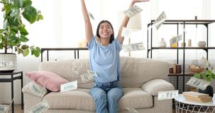 Woman throwing dollar bills in air