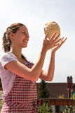 Woman is throwing a dough ball Stock Photos