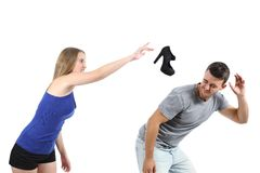 Woman throwing a heel shoe to a man royalty free stock images