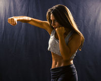 Woman throwing a hook punch royalty free stock images