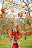 Woman throwing leaves Stock Photography