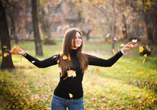 Woman throwing leaves Stock Photo