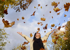 Woman throwing leaves Stock Photos