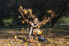 Woman throwing leaves in fall. Lifestyle autumn Royalty Free Stock Photos