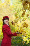 Woman throwing  maple  in autumn Stock Photography
