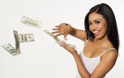 Woman throwing money. Happy beautiful young woman throwing money cash Stock Image