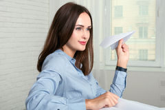 Woman throwing a paper plane Stock Images