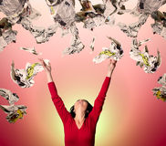 Woman throwing papers stock photography