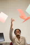 Woman throwing papers in the air Royalty Free Stock Image