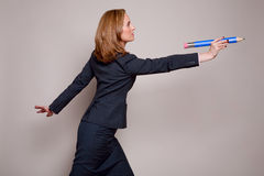 Woman throwing pencil Royalty Free Stock Photo