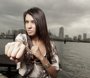 Woman throwing a punch Stock Images