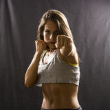 Woman throwing a punch Royalty Free Stock Photos