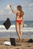 Woman throwing skirt on the beach Stock Photography