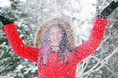 Woman throwing snow Royalty Free Stock Photo