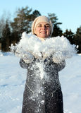 Woman throwing snow Stock Images
