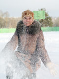 Woman throwing snow Stock Photo