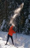 Woman throwing snowball. Female skier throwing snowball on a winter sunny day Royalty Free Stock Photos