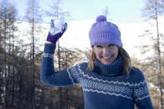 Woman throwing snowball Royalty Free Stock Image